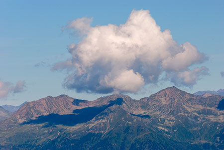 A mountain landscape with a big white cloud- JBLArts photography Fine Art Colours